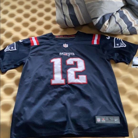 On Field Nike NFL Color Rush Tom Brady Jersey.